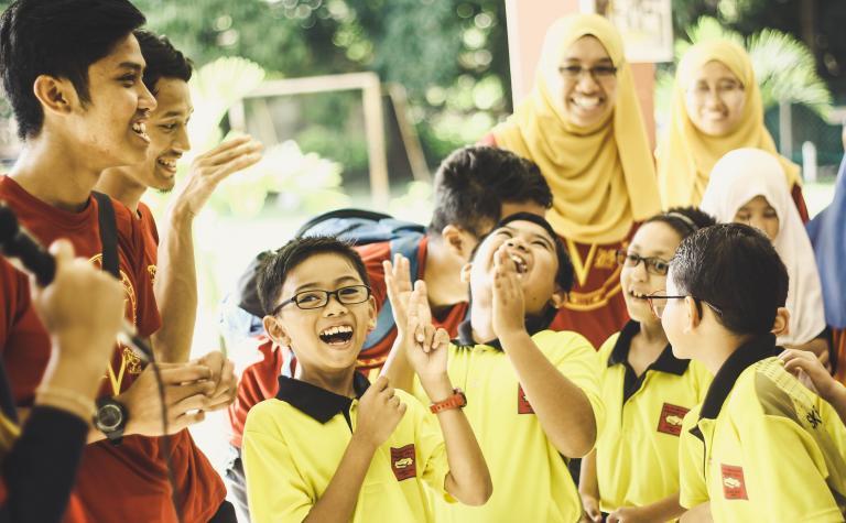 Children celebrating - all in a school uniform.